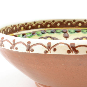 Decorative handmade clay interesting unique ethnic pottery bowl with ornament
