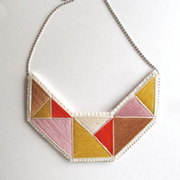 Statement bib necklace hand embroidered with light pink, taupe, red, yellow and cream colors geometric design Fall fashion trends