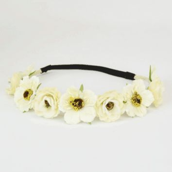 Add a springtime essential to your look with the Risen Garden Crown. Featuring a beige color braided faux suede design under of the flowers, two kind of faux floral attachments, and finished with an elastic (black color ) band.