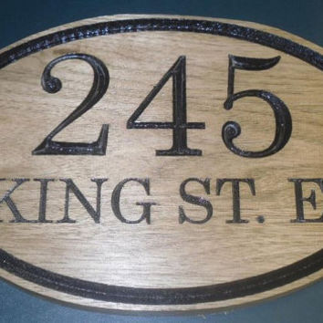 oval shaped, address carved wooden sign
