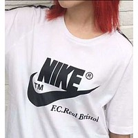 NIKE's new line of minimalist woven t-shirts  N-AG-CLWM