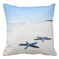 Two blue starfish at water's edge on tropical 2