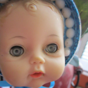Creepy upcycled baby doll. Doll on a stick. Up-cycled ooak. Blinking eyes