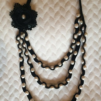 Pearl necklace with velvet ribbon and lace flower