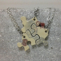 Puzzle Pieces Interlocking Pendants Pottery jewelry blue and maroon bubbles OOAK