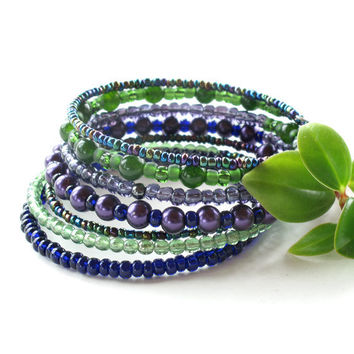 Stacking beaded bracelets - stack of 7 wrap around coils in shimmering purple, blue & green beads