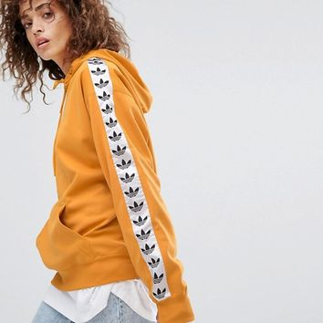 adidas Originals Tnt Tape Pullover Hoodie In Yellow at asos.com