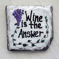 Refrigerator magnet Wine is the answer with vines and grape