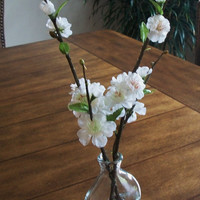 silk cherry blossom flowers in small vase