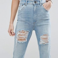 ASOS FARLEIGH High Waist Slim Mom Jeans In Sweet Mid Stonewash with Busted Rips at asos.com