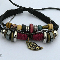 art brown leather bracelet with wooden bead and hollowed tube