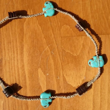 Hand made custom square knot hemp necklace with wood and sky blue elephant beads.