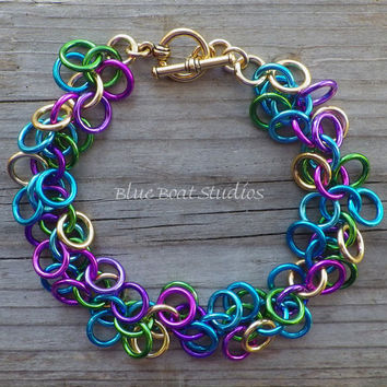 Blue, purple, green, and gold aluminum chain maille bracelet