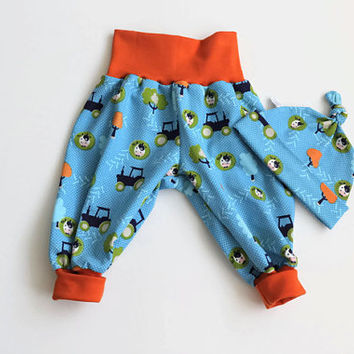 Aqua baby harem pants and knot hat set with cows and trees. Soft jersey knit with cows. Knotted hat and baggy pants. Orange waist band cuffs