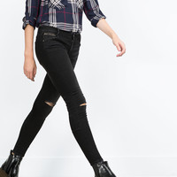 POWER STRETCH RIPPED JEANS