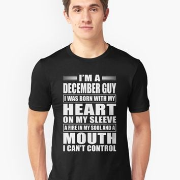 'I'm A December Guy' T-Shirt by phongtrandesign