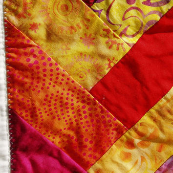Quilted Braided Design table runner in bright salsa colored batik fabrics