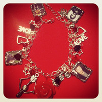 Norman Reedus - (Plays Daryl Dixon in The Walking Dead) Loaded Charm Bracelet