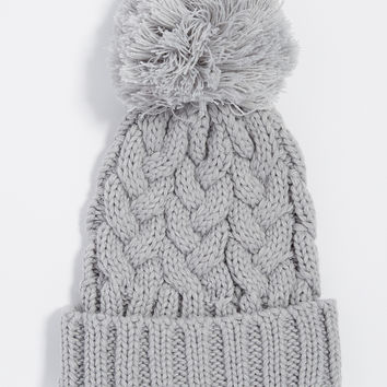 cable knit hat with pom-pom