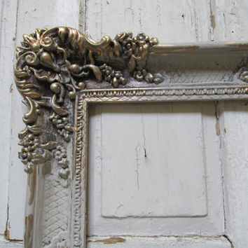 Large vintage frame ornate hand painted putty gray French farmhouse detailed antique silvery gold aged wall decor Anita Spero