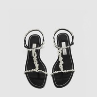 T-STRAP SLIDES WITH FAUX PEARLS DETAILS