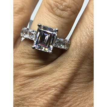 A Flawless 4.5CT Emerald Cut Halo Russian Lab Diamond Ring