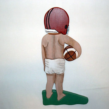 Football Recruit, dreaming of the future. Wood sculptured Wall Art for the walls