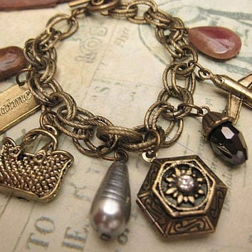 Old memories of Paris a locket charm bracelet by trinketsforkeeps