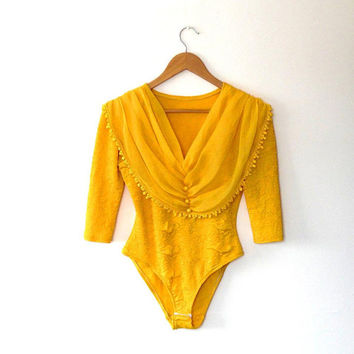 Mustard yellow retro leotard top / stretchy / rouched / chiffon collar / tassel trim / vintage / popper fasten / button / quarter sleeve top