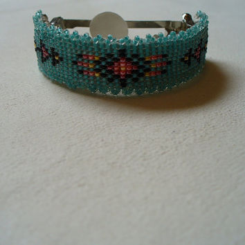 Native American Style loomes Pony tail barrette in green and fire colors