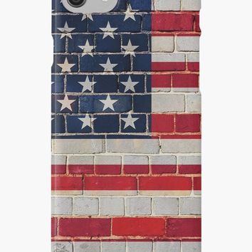 'America flag on a brick wall' iPhone Case/Skin by steveball