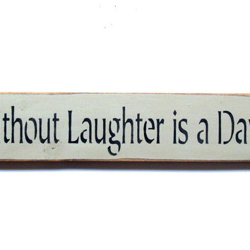 A Day Without Laughter Is A Day Wasted, wooden sign