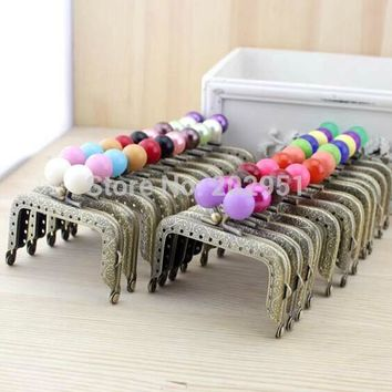 7.5cm 20pcs/lot Retro pattern sewing metal purse frame with center candy kiss clasp patchwork bag handle making supplies parts
