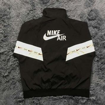 NIKE 2018 autumn and winter models men and women loose trend string stitching jacket Black