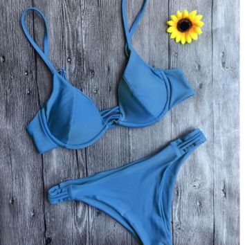Fashion blue pure color gather type bottom side hollow chest cross two piece bikini