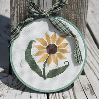 Completed Cross Stitch of a Brown Eyed Susan in a by Stitchcrafts