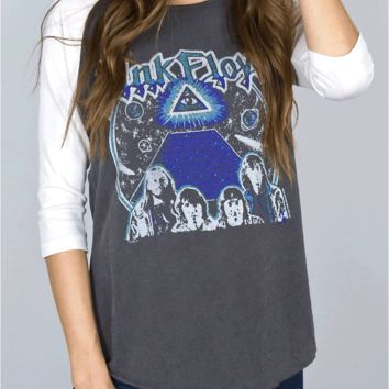 Falling in love with your favorite band in this vintage inspired Pink Floyd Raglan by Junk Food Clothing! This soft raglan vintage washed top features raw edge round neckline, contrast with ivory color 3/4 sleeves, high and low shirttail bottom hem and raw