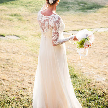 Long sleeve lace wedding dress with stunning silk slip