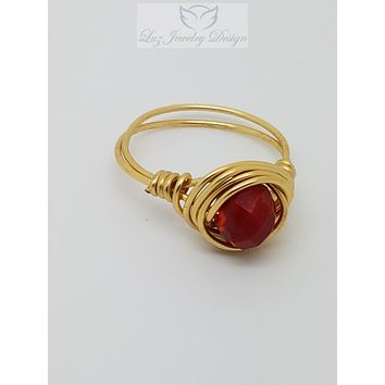 Gold orange and red three stone ring