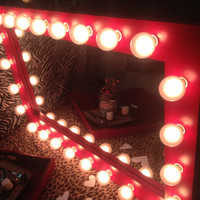 "Lighted vanity make up mirror called "" Valentine"" A set of (24) (G50) globe lights included! Pine wood frame painted red with a clear coat."