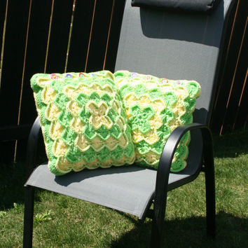 Two Crochet Catherine's Wheel Throw Pillow Covers in Yellow and Green With Colorful Fish Buttons