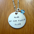 "Hunger Games Inspired Necklace. Katniss Peeta ""real or not real?"". Hand stamped, silver colored, charm pendant, Swarovski crystal, jewelry."