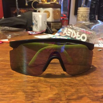 vintage oakley razor blade sunglasses with purple lens