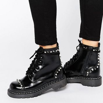 T.U.K. Anarchic Stud Lace Up Chunky Leather Flat Ankle Boots at asos.com