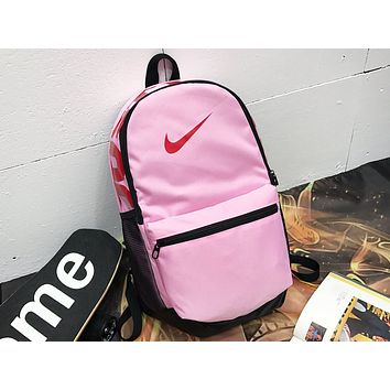 NIKE sells casual men's and women's shopping bags with fashionable printed stitching backpacks Pink