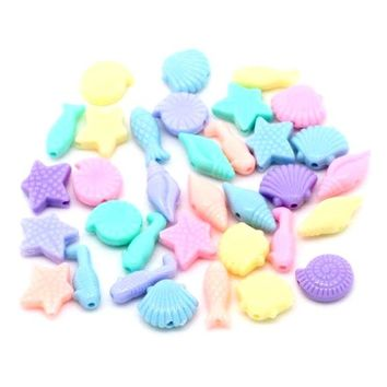 Pack of 50 Assorted Pastel Acrylic Ocean Theme Beads. Fish, Seashells and Stars. Plastic Charms for Children's Handmade Craft and Jewellery