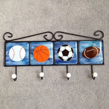 Four hook metal coat rack with four hand cut fused glass tiles with sports balls baseball  basketball soccer football