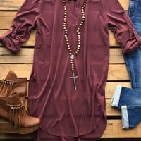 Our Two Story House Tunic Top is the perfect shade of fall! It's a suede like tunic top with roll-up sleeves. Has a v-neckline with flat collar. Has long slits up the sides. Very soft and comfortable.