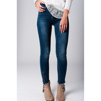 Jeans with ankle zip detail and fray hem