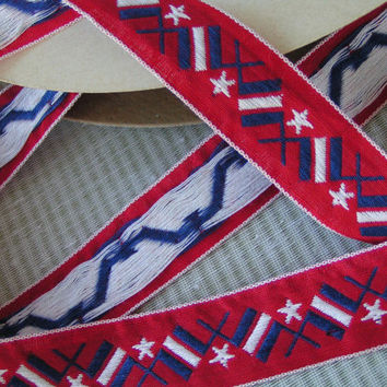 Nautical Jacquard Ribbon, Message Flags ribbon in red, white and blue plus white stars on a red background edged in white.